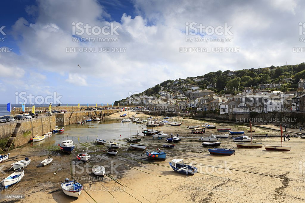 fishing boats in the harbour of Mousehole at low tide royalty-free stock photo