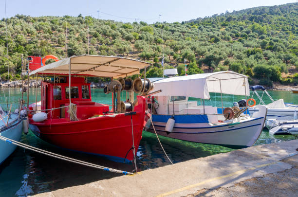 Fishing boats in the picturesque little harbor of Steni Vala village, Alonnisos island, Greece stock photo