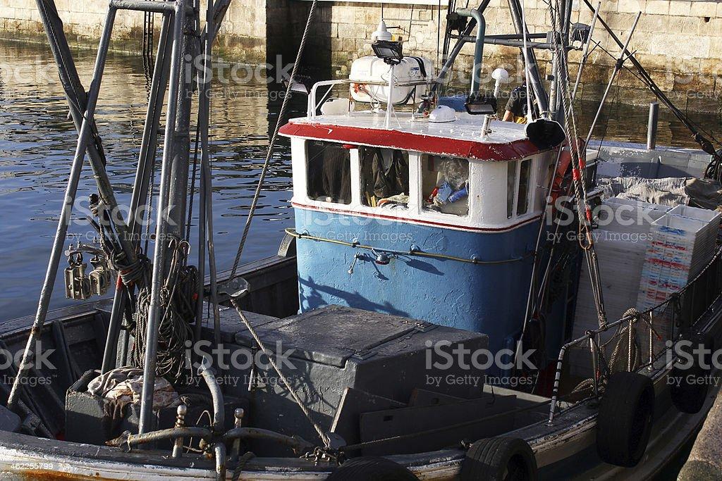fishing boats moored at the port royalty-free stock photo