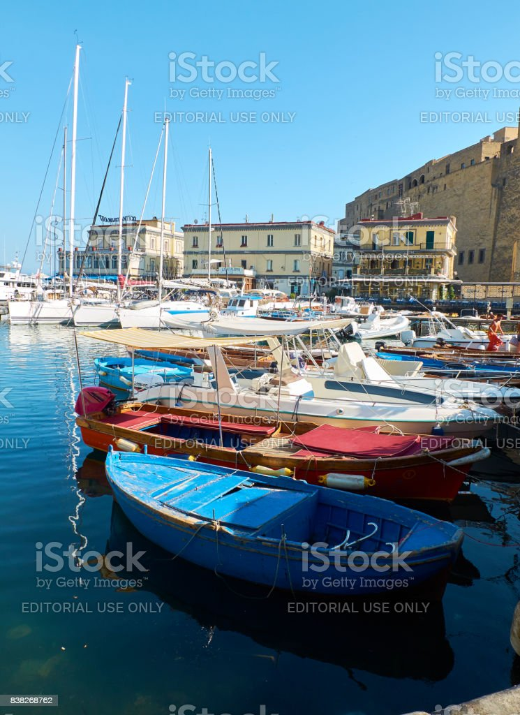 Fishing boats moored in Borgo Marinari harbor. Naples, Italy. stock photo