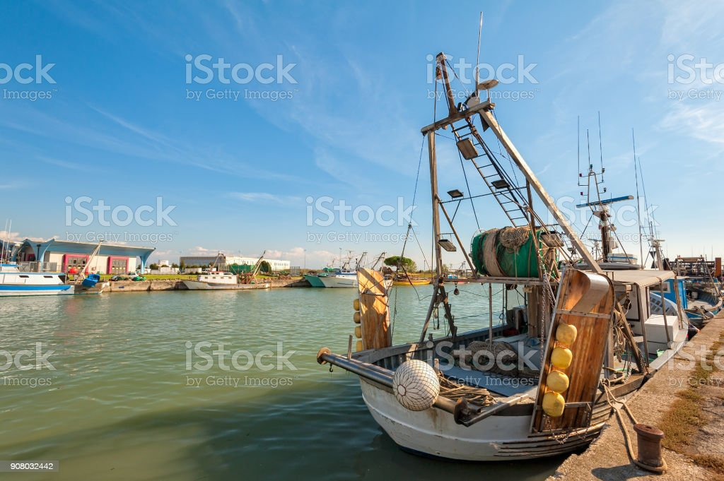 Fishing boats moored in harbor. stock photo