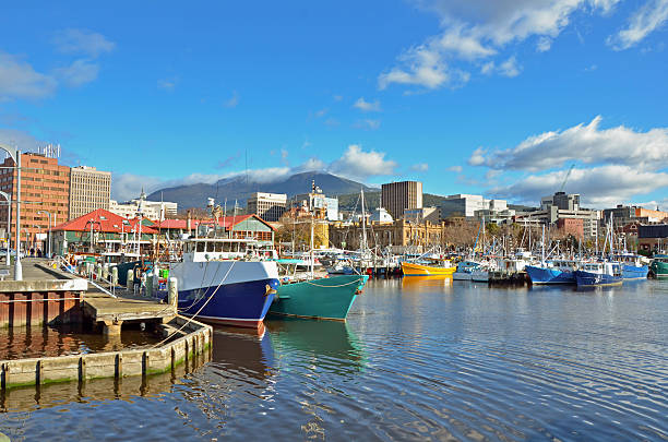 fishing boats moored to the quay in hobart harbour - tasmania stock pictures, royalty-free photos & images