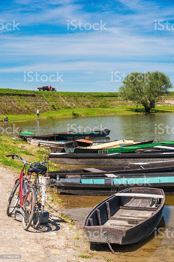 Fishing boats near the river beach stock photo