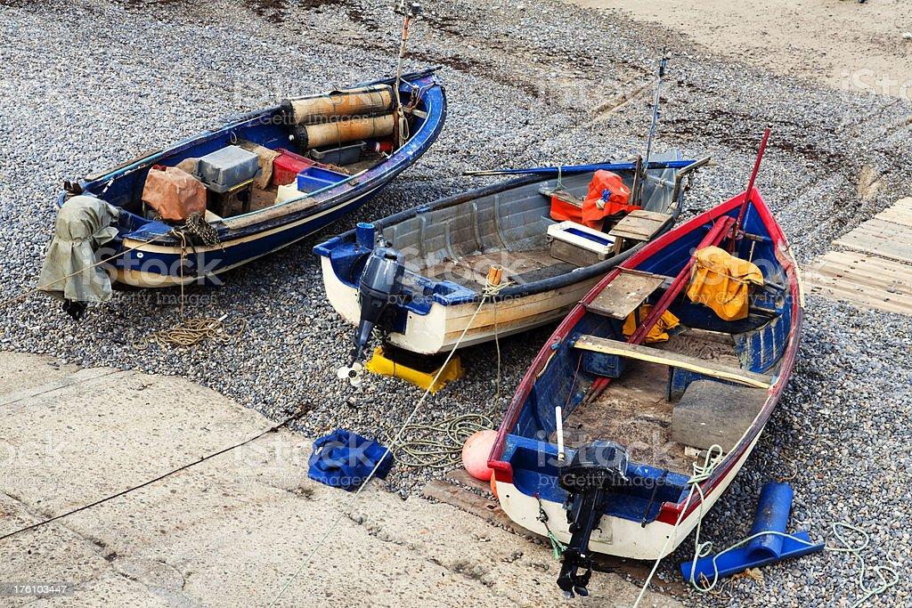 Fishing boats on a pebbly Norfolk beach royalty-free stock photo