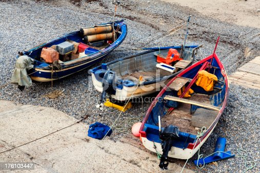 Fishing boats pulled up onto a slipway on  Sheringham beach in Norfolk, England.