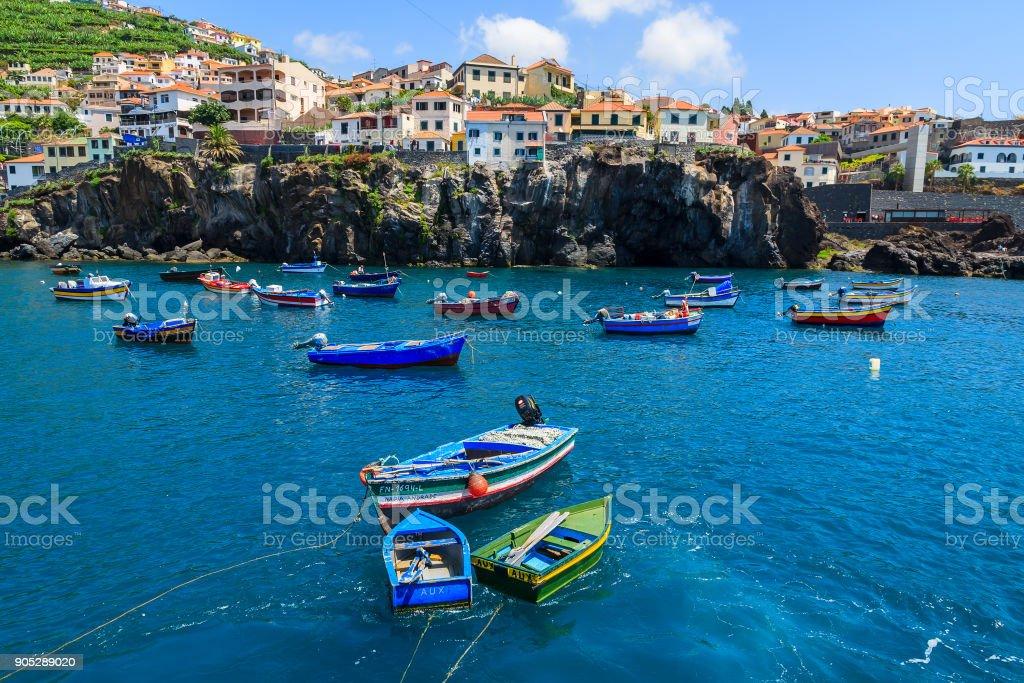 Fishing boats on sea in Camara de Lobos port, Madeira island