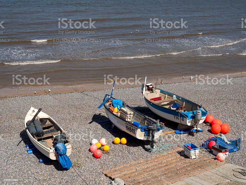 Fishing boats on Sheringham beach stock photo