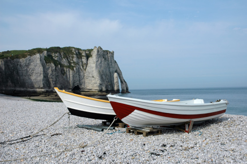 France: view of the beach and fishing boats in Etretat, France on May 29, 2015. Bad weather