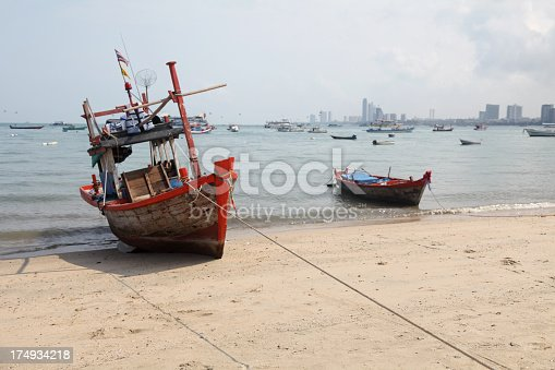 Fishing boats stranded on the beach in Pattaya, Thailand