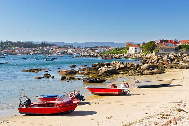 Fishing boats on the beach stock photo
