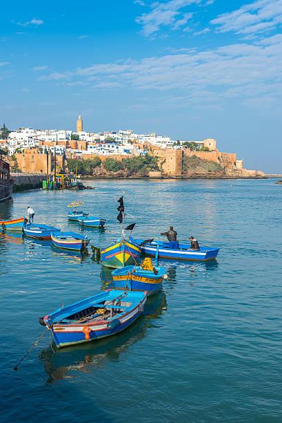 fishing boats on the bou regreg river in rabat port. - rabat marocko bildbanksfoton och bilder
