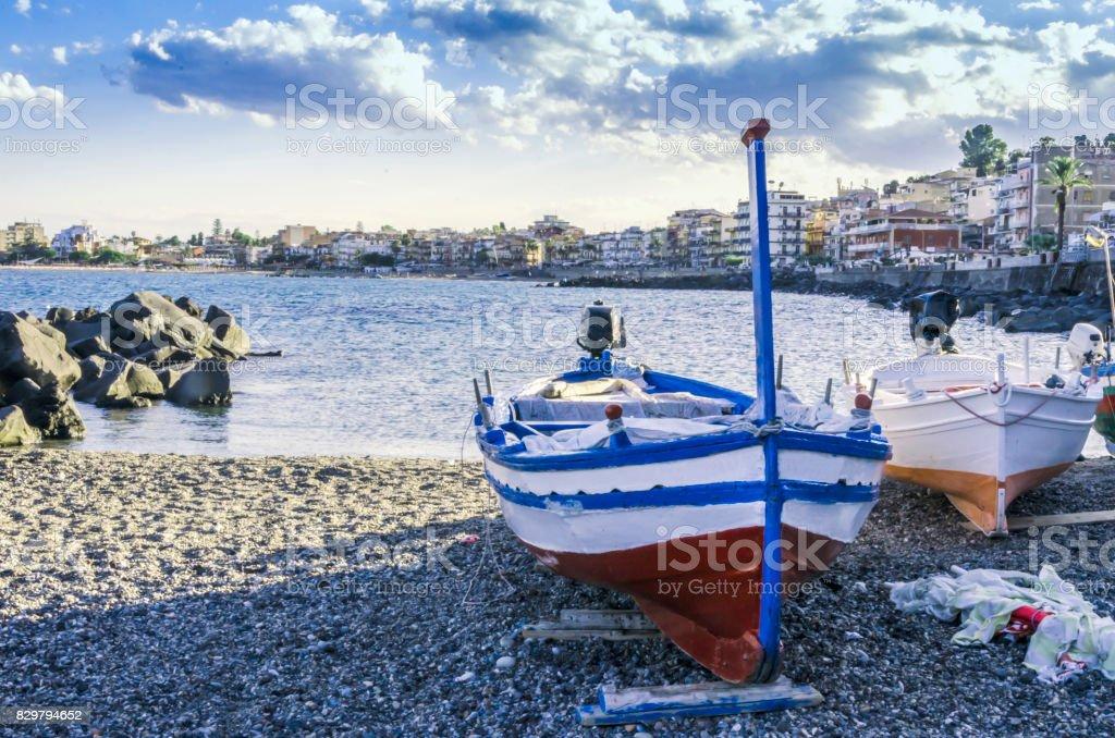 Fishing boats on the coast of the city of giardini naxos sicily stock photo