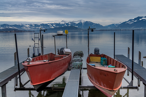 Fishing boats on the tiny harbor of the village of Hurden, on the shores of the Upper Zurich Lake (Obersee),Schwyz, Switzerland.