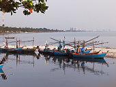 Fishing boats parking on the beach at Huahin, Thailand.
