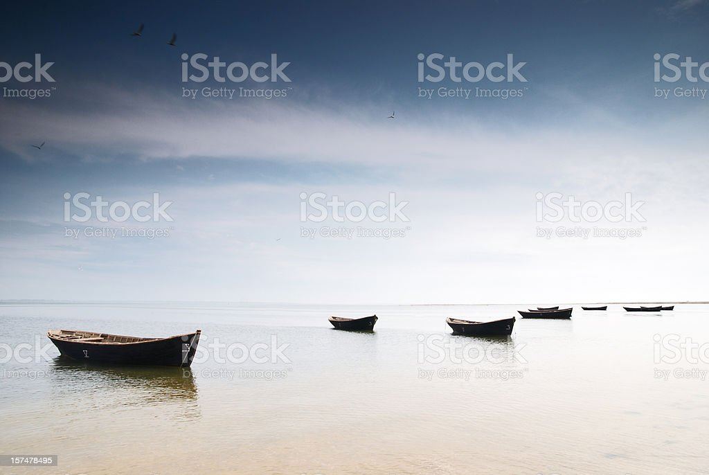 fishing boats fishing boats Back Lit Stock Photo