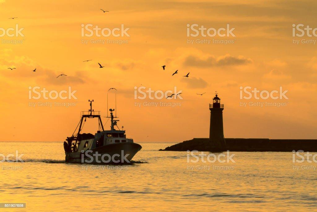 Fishing Boats Returning to Port stock photo