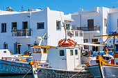 Fishing boats tied up at a dock in Naoussa port, Paros, Greece. Typical fishing boats anchored in harbour