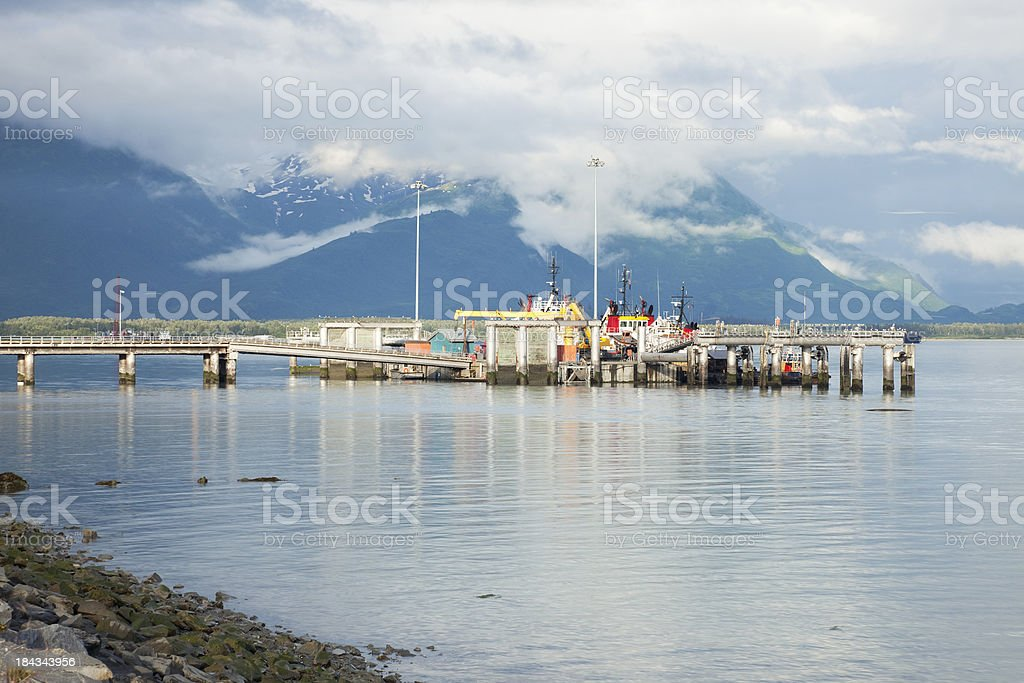 Fishing boats unloading Salmon in Valdez Alaska Harbor stock photo