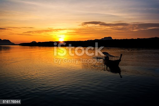 115874504istockphoto Fishing boats with morning sun. 516176544