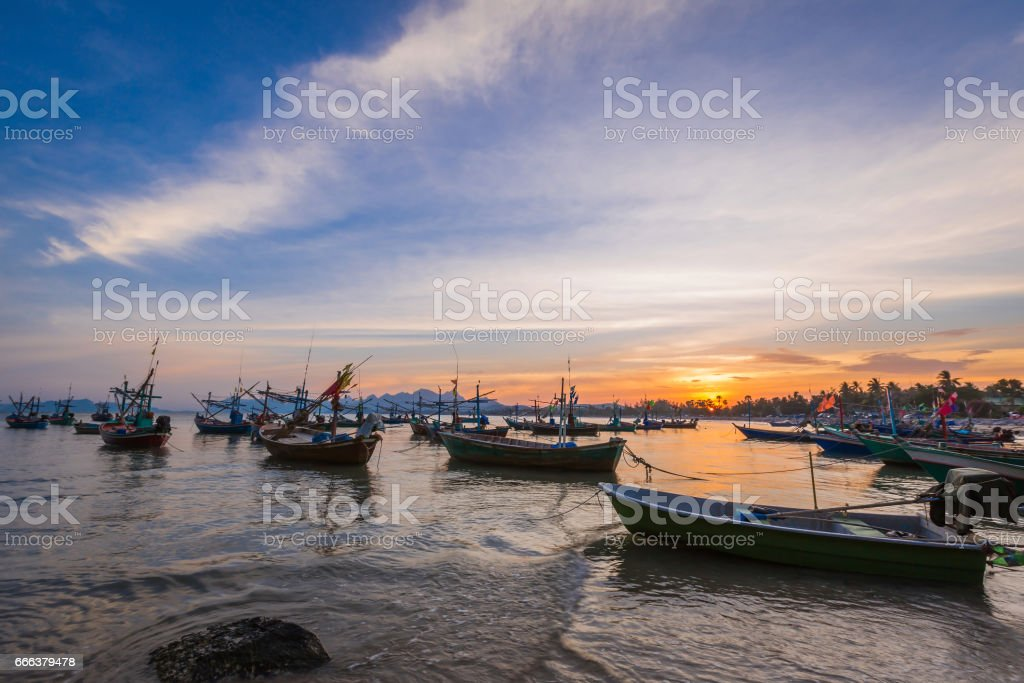 Fishing boat,waves and sunset with blue sky, idustrial background. stock photo