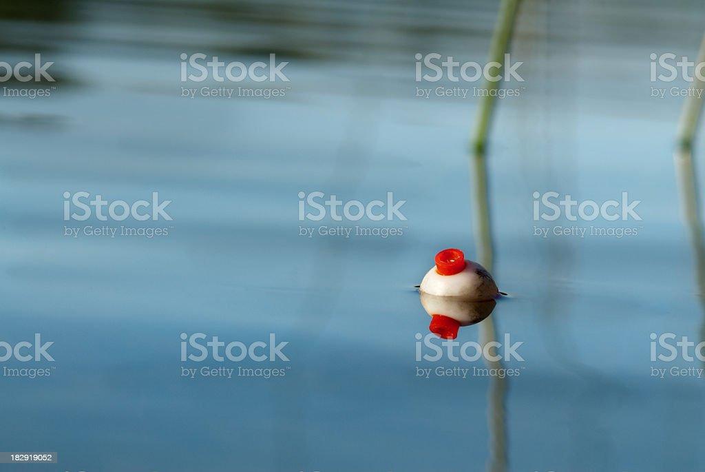 Fishing bobber on still water stock photo