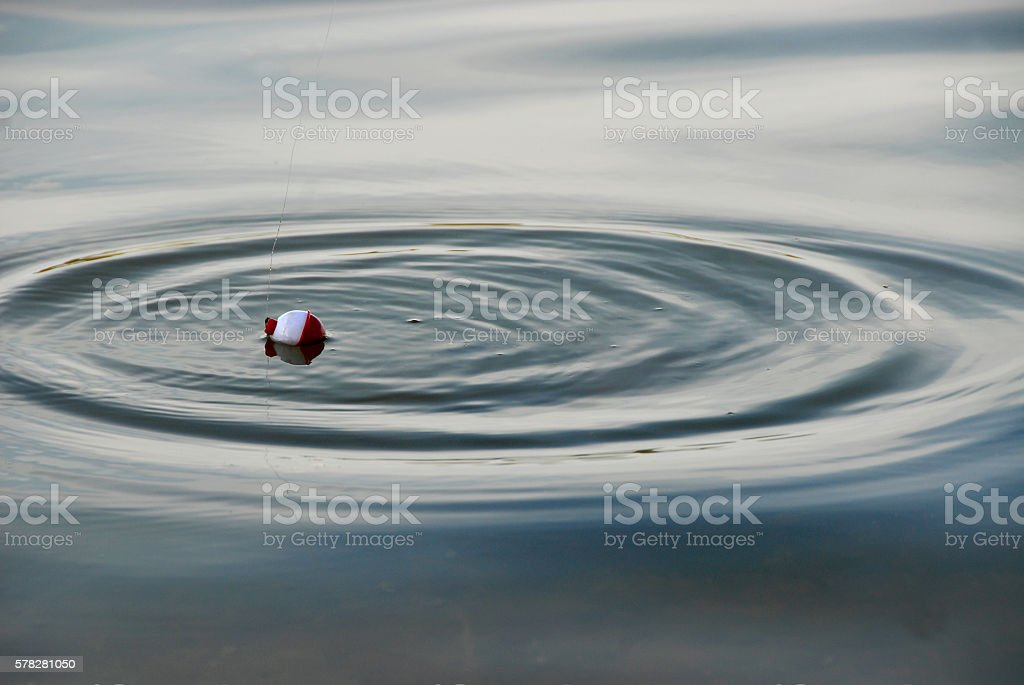 Fishing Bobber with Ripples stock photo