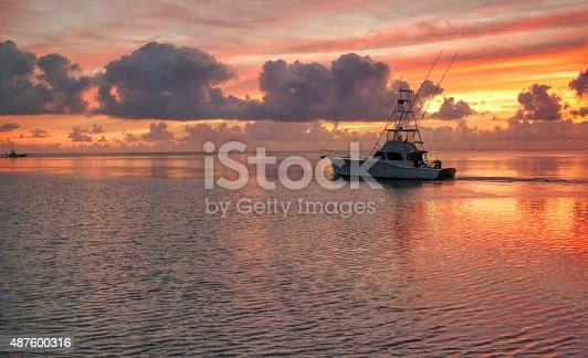 A fishing charter boat leaves very early in the morning from the Florida Keys