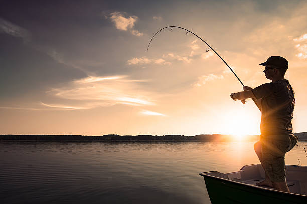 Royalty free fishing pictures images and stock photos for Best time for bass fishing