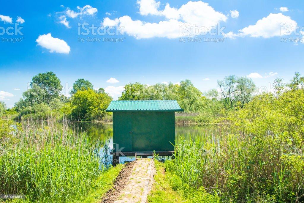 Fishing cottage on lake royalty-free stock photo