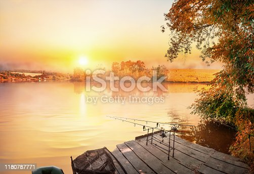 1094918172 istock photo Fishing equipment on wooden pier 1180787771