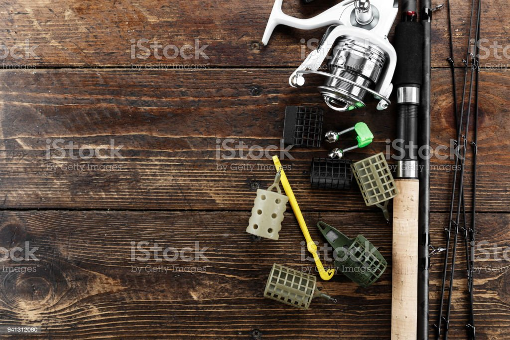 Fishing feeder and reel. Different tips of the feeder rod for bottom fishing stock photo