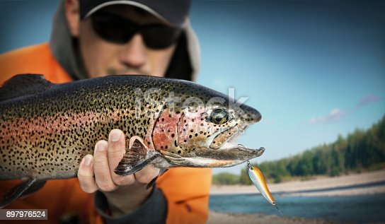 istock Fishing. Fisherman and trout. 897976524