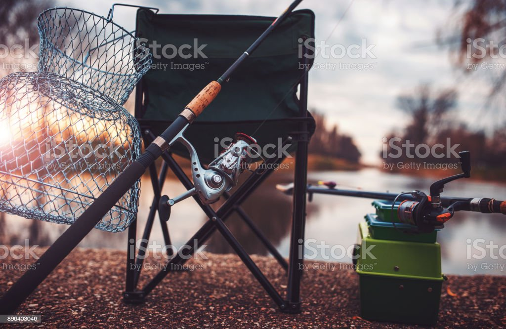 Fishing. Fishing equipment at the sunset. Sport, recreation concept stock photo