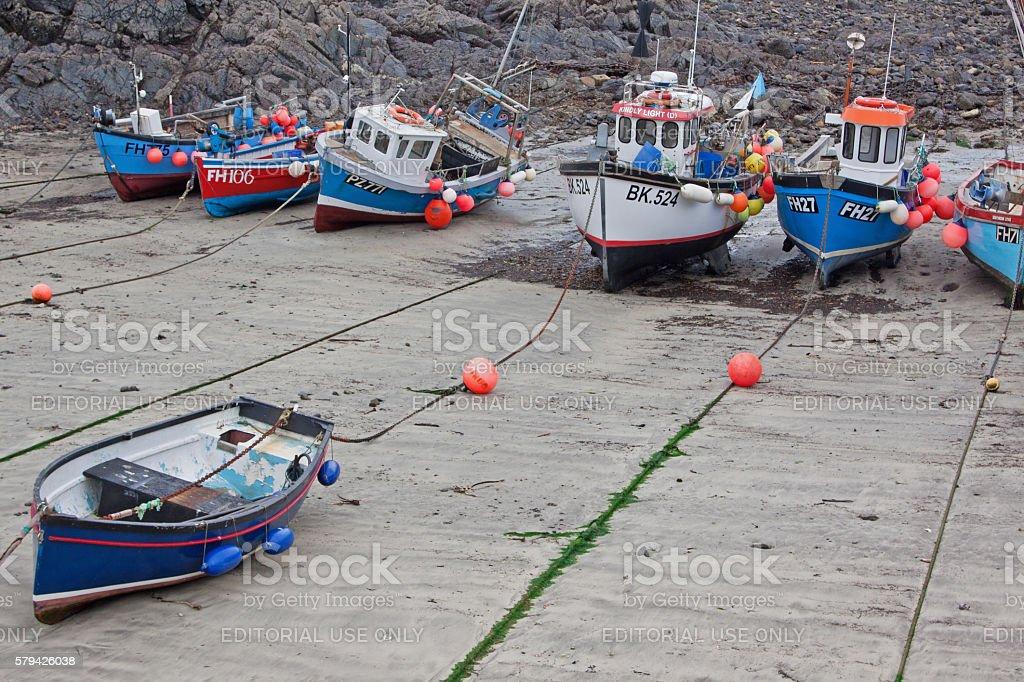 Fishing fleet at low tide stock photo