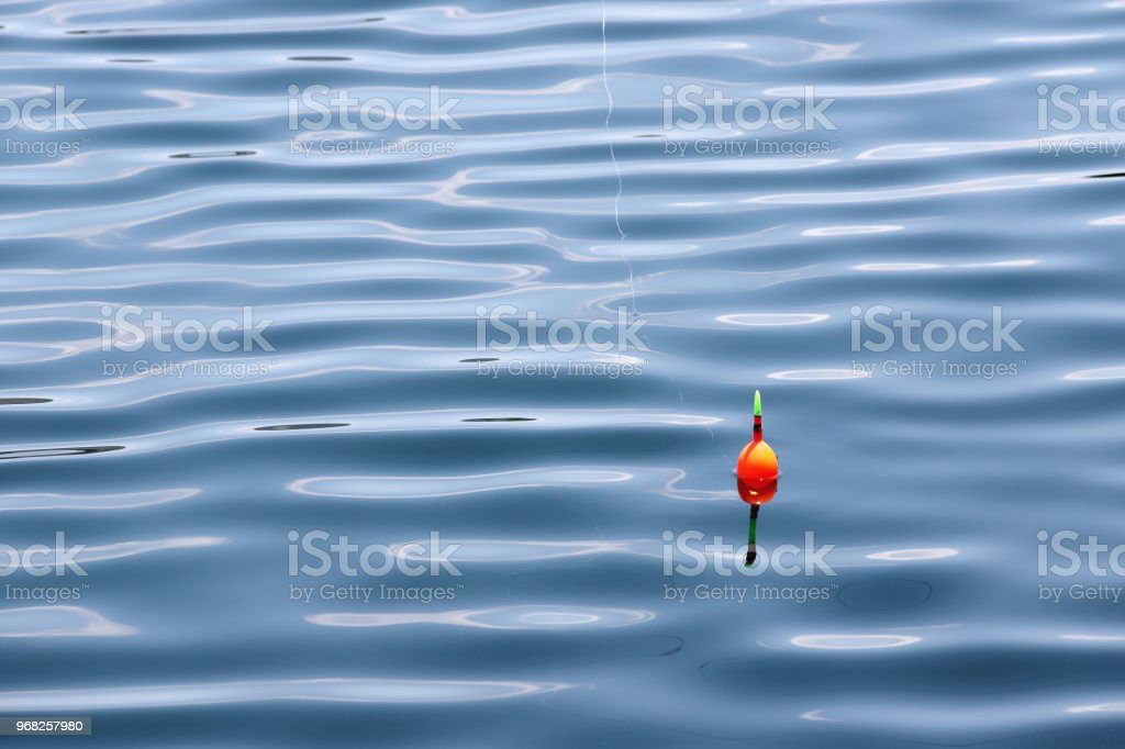 Fishing float for fishing in water stock photo
