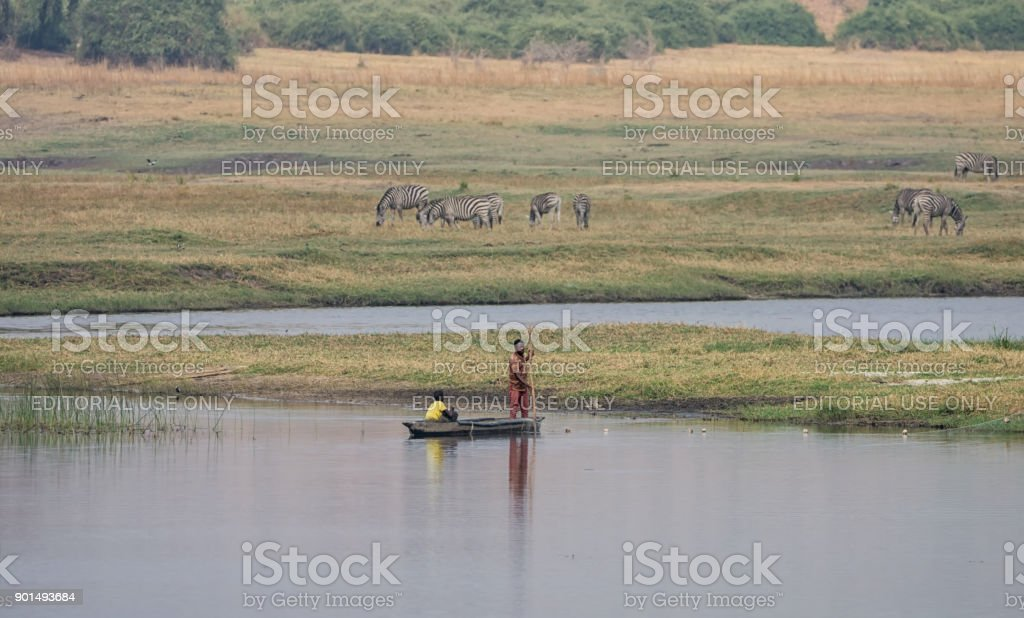 Fishing from A Dugout Canoe stock photo