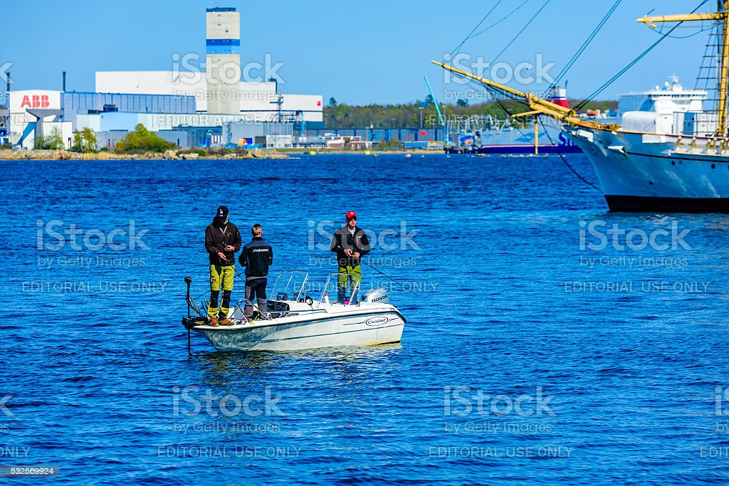 Fishing from motorboat stock photo