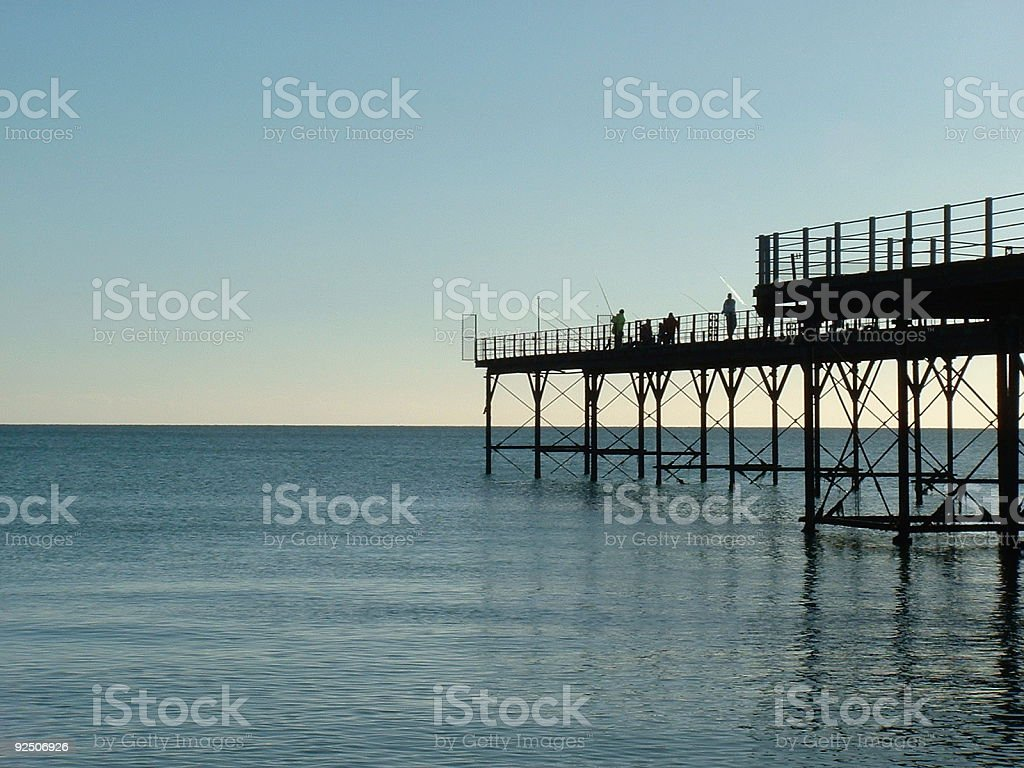 Fishing from pier royalty-free stock photo