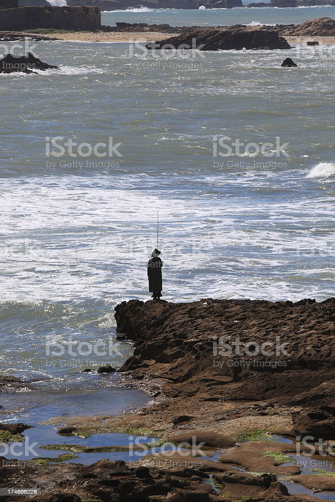 Fishing from the rocks royalty-free stock photo