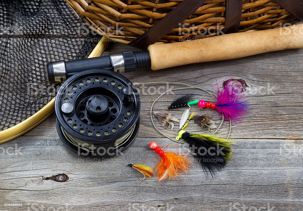 Fishing Gear on Rustic Wood stock photo