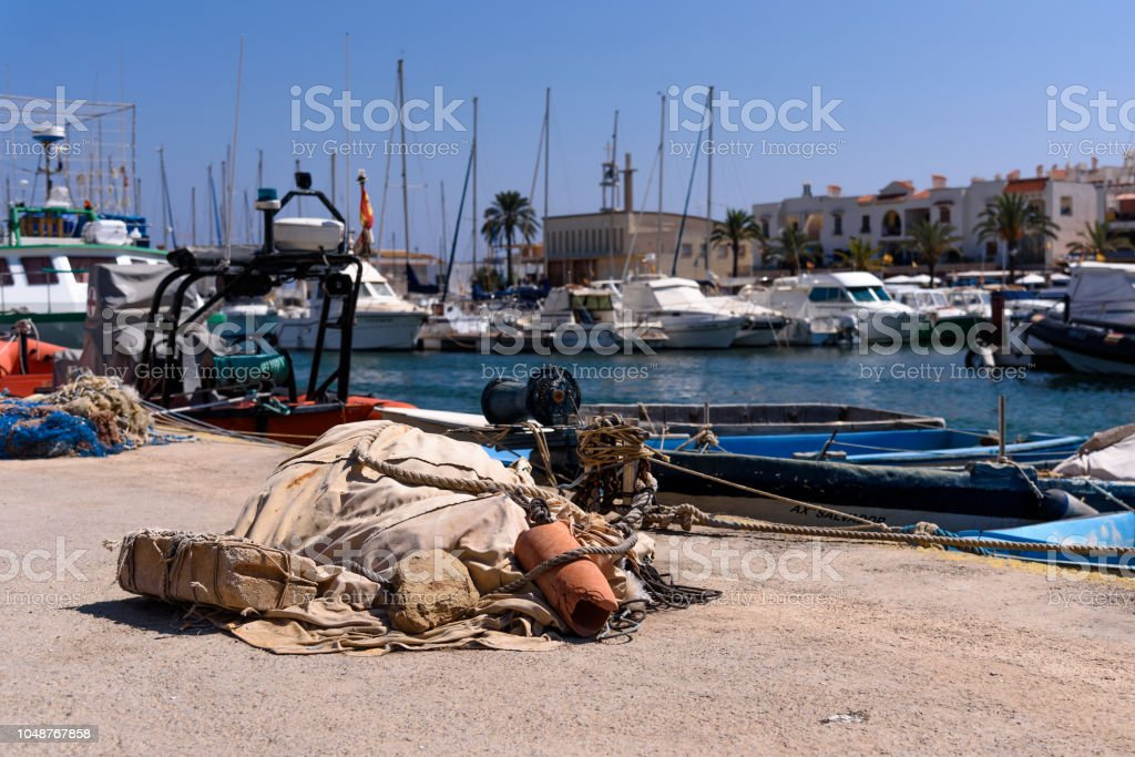 Fishing gear, on the edge of a dock, in the port of Cabo de Palos, in Murcia, Spain, in the southern Mediterranean stock photo
