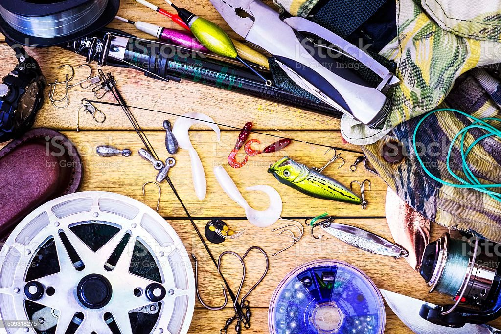 Fishing gear on the table as a frame Fishing tackle on a table in a frame, the theme hobby sport Activity Stock Photo