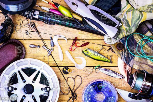 Fishing Gear On The Table As A Frame Stock Photo - Download Image Now
