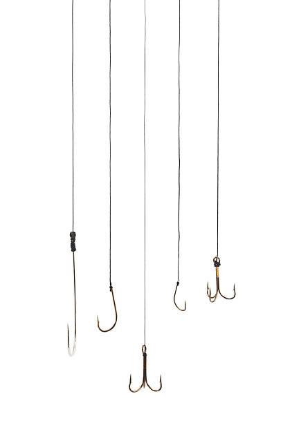 Fishing hooks Fishing hooks on white background. fishing hook stock pictures, royalty-free photos & images