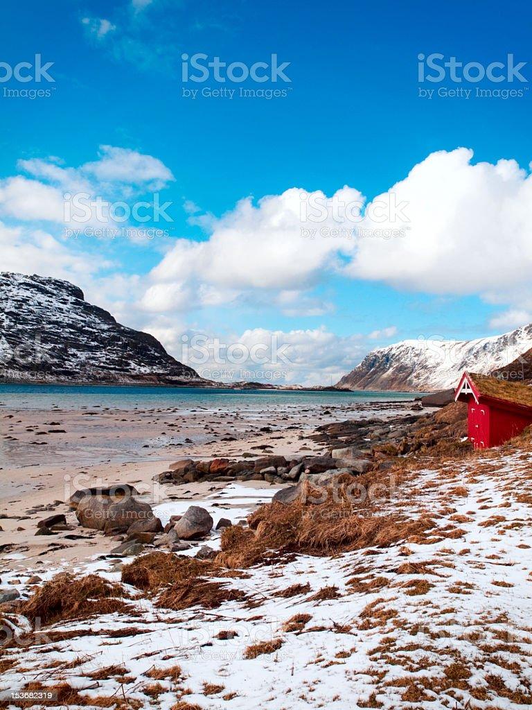 Fishing hut at Flakstadpollen fjord royalty-free stock photo