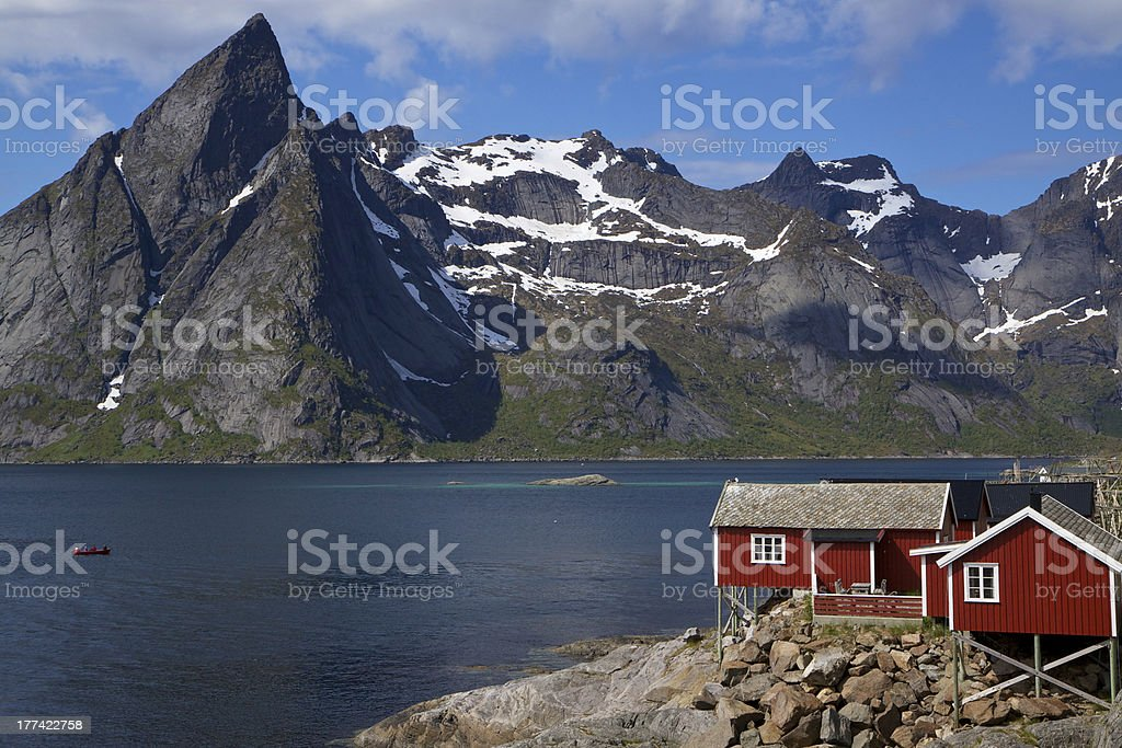 Fishing hut by fjord stock photo