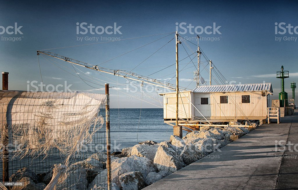 Fishing hut on the harbour channel stock photo
