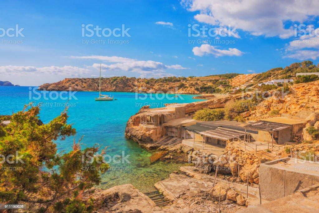 Fishing Huts And Bay Of Cala Tarida On Ibiza Stock Photo