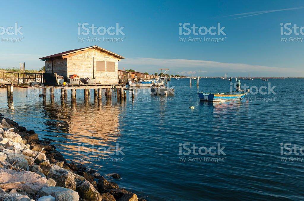Fishing huts and boats at Scardovari lagoon, Rovigo, Italy stock photo