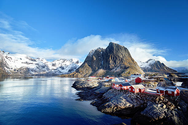 fishing huts at spring day - reine, lofoten islands, norway - fjord stock photos and pictures